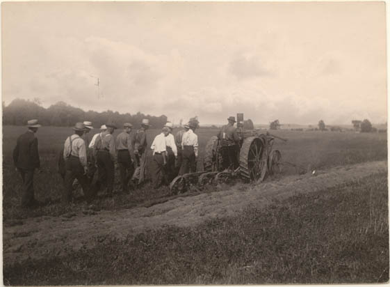 Ploughing match contestant with judges