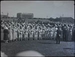 Historic photo from Wednesday, July 4, 1934 - Mace Ceremony, Fort York, with Tip Top building in distance in Fort York