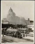 Historic photo from 1920 - Steam engines, eastern entrance to Union Station, Toronto, with the Royal York Hotel in the background in Financial District