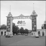 Historic photo from 1958 - Dufferin Street gate decorated for the 80th anniversary of the CNE in CNE