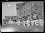 Historic photo from 1940 - Cameron House Hotel on Queen Street West - parade going by in Alexandra Park