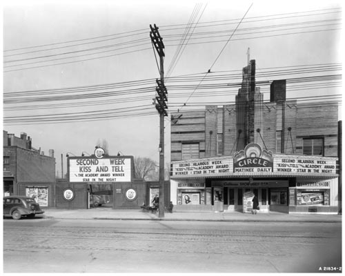 Marquee of Circle Theatre, and theatre parking lot and street, Toronto