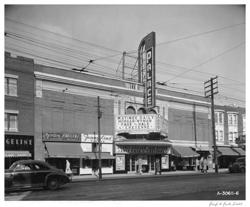 Marquee and sign on exterior of Palace Theatre, and street, Toronto